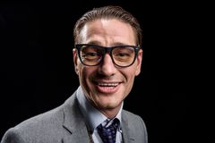 Delighted stylish businessman is expressing gladness. Full of joy. Portrait of easygoing optimistic young male entrepreneur in glasses is standing and looking at royalty free stock photos