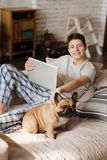 Delighted teenager posing on camera with his pet Stock Image