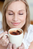 Delighted woman drinking a coffee Royalty Free Stock Photos