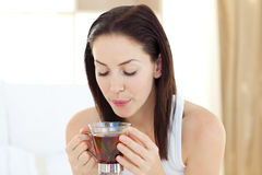 Delighted woman drinking tea Stock Photography