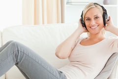 Delighted woman enjoying some music Royalty Free Stock Photo