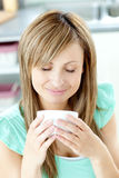 Delighted woman holding a cup of coffee Stock Images