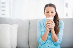 Delighted woman holding cup of coffee Royalty Free Stock Photography