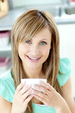 Delighted woman holding a cup of tea Royalty Free Stock Image