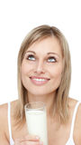 Delighted woman holding a glass of milk Stock Images