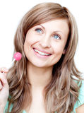 Delighted woman holding a lollipop Royalty Free Stock Image
