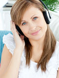 Delighted woman listening to music with headphones Royalty Free Stock Images