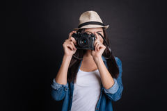 Delighted woman making photos Stock Image