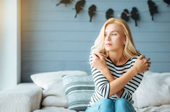 Delighted woman posing in cozy bedroom Stock Images