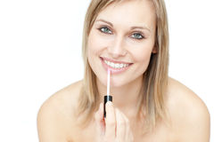 Delighted woman putting gloss Stock Photography