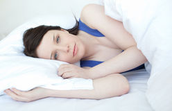 Delighted woman relaxing on a bed Royalty Free Stock Photography