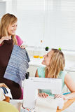 Delighted woman sewing with her friend Stock Photos