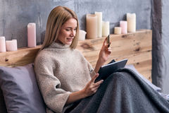 Delighted woman shopping online in bed Royalty Free Stock Image