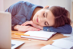 Delighted woman sleeping at the table Royalty Free Stock Photos