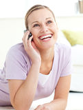 Delighted woman talking on phone Stock Photo