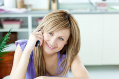 Delighted woman talking on the phone Stock Photo