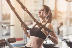 Delighted woman training hard in a gym Royalty Free Stock Photos