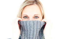 Delighted woman wearing a polo-neck-sweater Stock Images