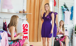 Delighted women choosing clothes together Royalty Free Stock Photos