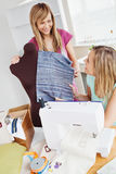 Delighted women sewing at home Royalty Free Stock Images