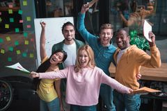 Delighted young business colleagues are celebrating successful of project Royalty Free Stock Image