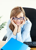 Delighted young businesswoman sitting at her desk Royalty Free Stock Image