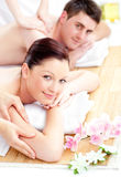 Delighted young couple receiving a back massage Stock Photo