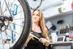 Delighted young craftswoman working in the repair shop Royalty Free Stock Images