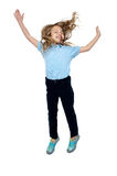 Delighted young girl jumping high in the air Royalty Free Stock Photography
