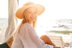 Delighted young girl in summer hat and swimwear Stock Photo