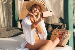 Delighted young girl in summer hat and swimwear Royalty Free Stock Photography