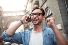 Delighted young man making a phone call Royalty Free Stock Photography