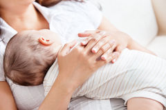 Delighted young mother taking care of her baby Royalty Free Stock Photos
