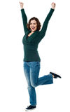 Delighted young woman dancing Stock Photo