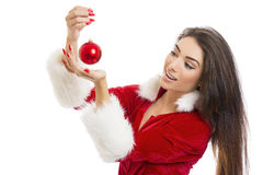 Delighted young woman holding red bauble Stock Images
