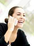 Delighted young woman listening to a phone call Royalty Free Stock Images