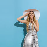 Delighted Young Woman In Sun Hat Is Looking Up Stock Image