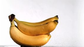 Delightful bananas in super slow motion being wet stock video footage