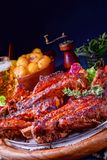 Delightful BBQ Spareribs from the Smoker. A Delightful BBQ Spareribs from the Smoker royalty free stock photography