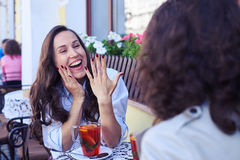 Delightful bride showing wedding ring to friend Royalty Free Stock Photo