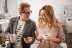 Delightful business colleagues enjoying coffee break at work Royalty Free Stock Images
