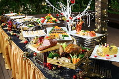 Delightful Christmas buffet with roasted chicken, beef, pork, se Royalty Free Stock Photos