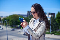 Delightful female surfing on mobile phone Royalty Free Stock Images