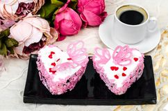 Delightful, luxury, romantic cake in the form heart. Valentine`s Day on February 14. Studio Photo stock photography