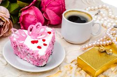 Delightful, luxury, romantic cake in the form heart. Valentine`s Day on February 14. Studio Photo royalty free stock images