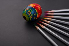 Painted easter egg concept on black background. royalty free stock photography