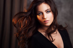 Delightful portrait of a woman brunettes, hair flying on the wind, sloppy styling Royalty Free Stock Photography