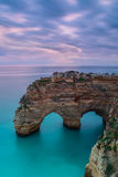 Delightful seascape arch at sunset. Marinha Beach. Stock Photos