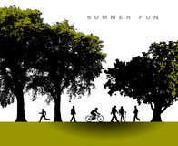 A delightful summer time park scene. With people enjoying a variety of activates Royalty Free Stock Photos