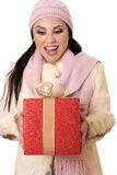 Delightful Surprise - Female holding a large red and gold gift Royalty Free Stock Photo